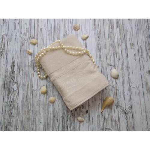 Купить Махровое полотенце подарочное 70х140 бежевое ЛОРАН  по цене от 1 040 Р. с доставкой